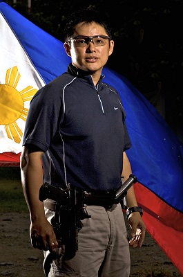 Image: Jethro Dionisio in front of the Philippines flag